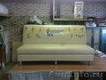 Профессиональная обшивка дивана в мастерской